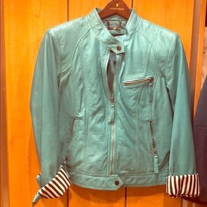 Teal real leather jacket, wear sleeve rolled up